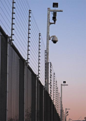 Security Fence: While in jail I couldn't help noticing the similar aesthitic of the prison and the Olympic enclosure which is surrounded by 17.5km of electric fence, on which there are 900 day and night vision cameras   © Mike Wells