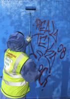 Daily graffiti removal from the Blue Fence