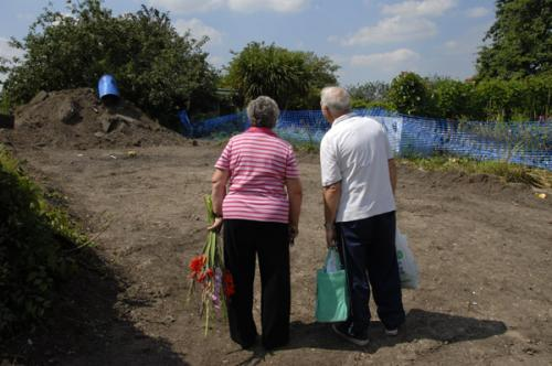 Len and Margaret Loft looking at one of the wrecked plots in August.
