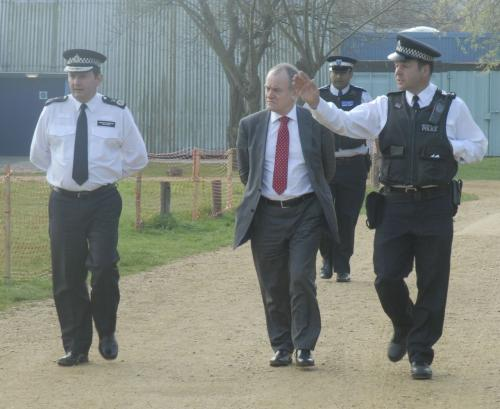 Met Police Assistant Commissioner (left) and an unknown man (suit) arrive at Leyton Marshes