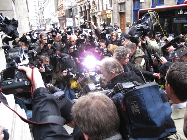 London - media scrum: dumbed down the media is largely failing in its duty, almost never seriously challenging the status quo, and largely failing to inform and investigate