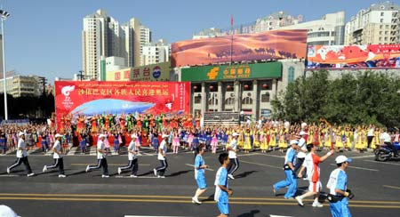 .: The Olympic flame passes brightly through somewhere in the the Uyghur Autonomous Province !